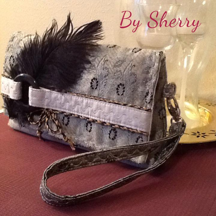 The Kiss Clutch by Sherry