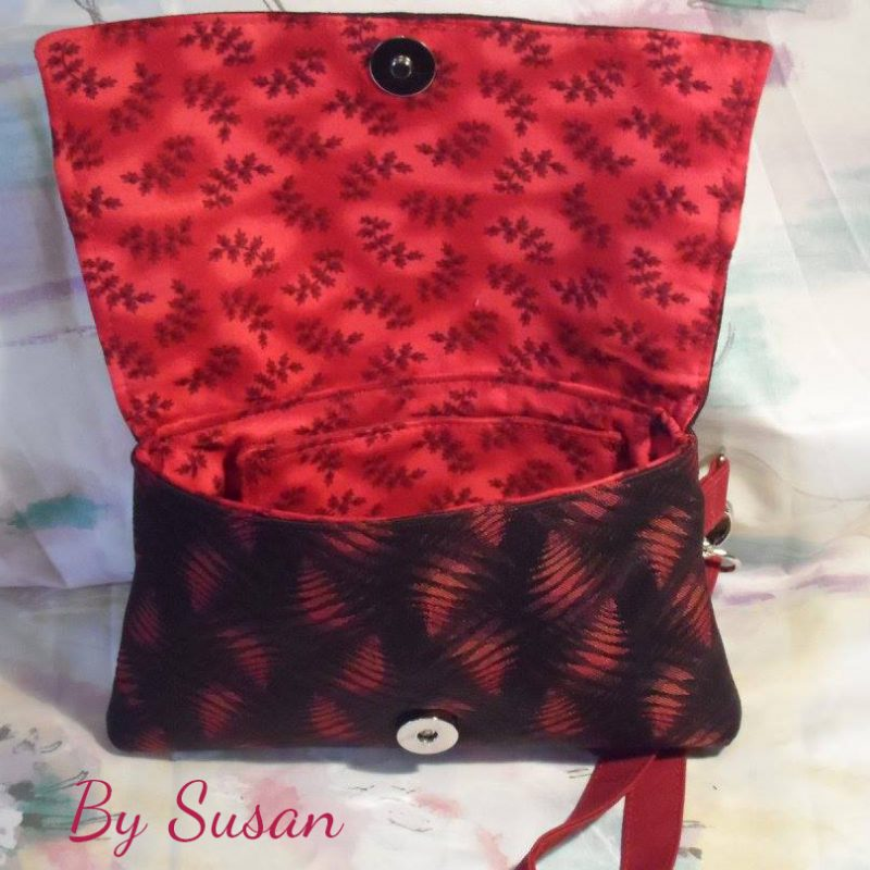 The Kiss Clutch by Susan